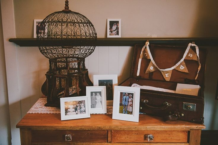 A gift table using our Victorian birdcage and a leather suitcase.