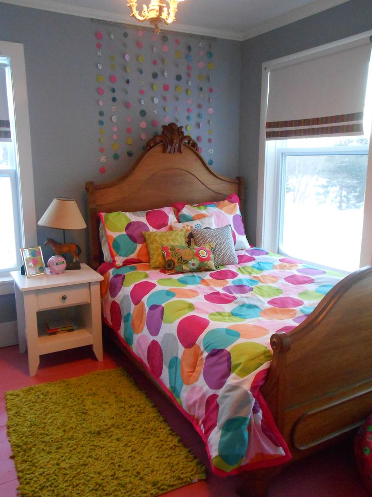 Tween room make over.  Scrapbook paper circle hanging wall art over the bed.