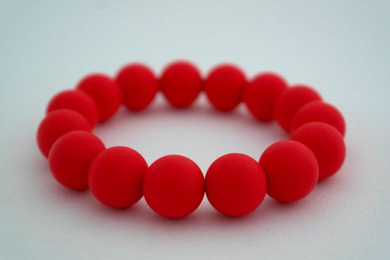 Silicone Teething Bracelet in Racy Red. Mummy jewellery that baby can chew