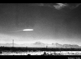 UFO Over Holloman Base  An unidentified flying object was photographed by a government employee over the Holloman Air Development Center in New Mexico in 1964. Conspiracy theorists have claimed the photo is proof that the U.S. government has been in contact with aliens.