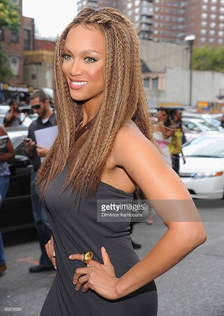Model Tyra Bank visits 'The Tyra Banks Show' celebration of the first all black model issue of Vogue Italia on August 12, 2008 in New York City.