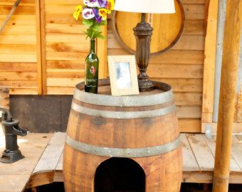 Pet House made from wine or whiskey barrels.  Rustic pet houses for dogs or cats.