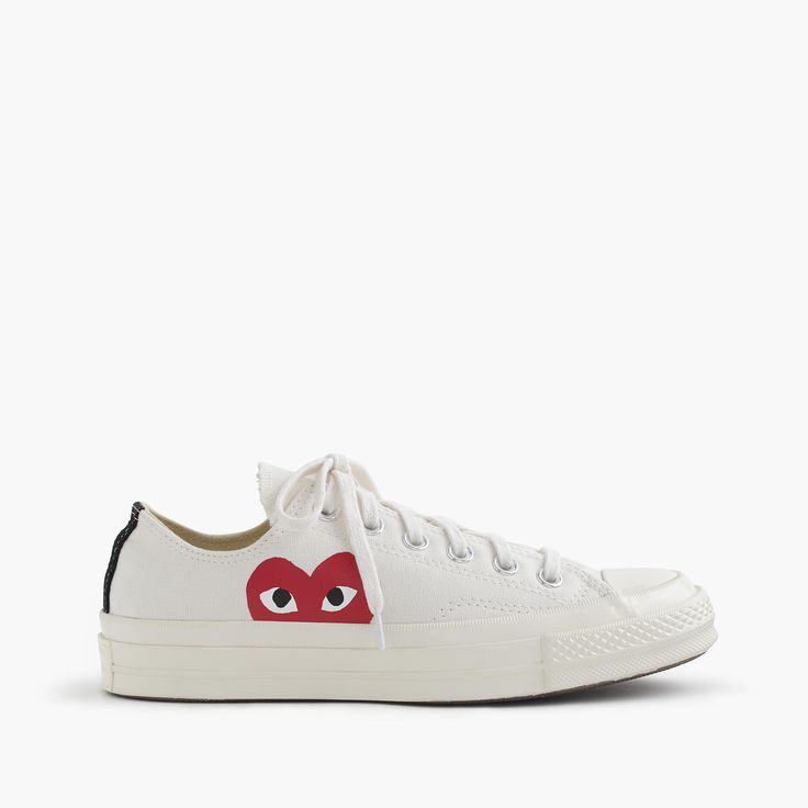 Comme des Garçons® low-top sneakers item C5602 $125.00       Cotton upper and lining.     Rubber sole.     Import.     Online only.     Half sizes order down.