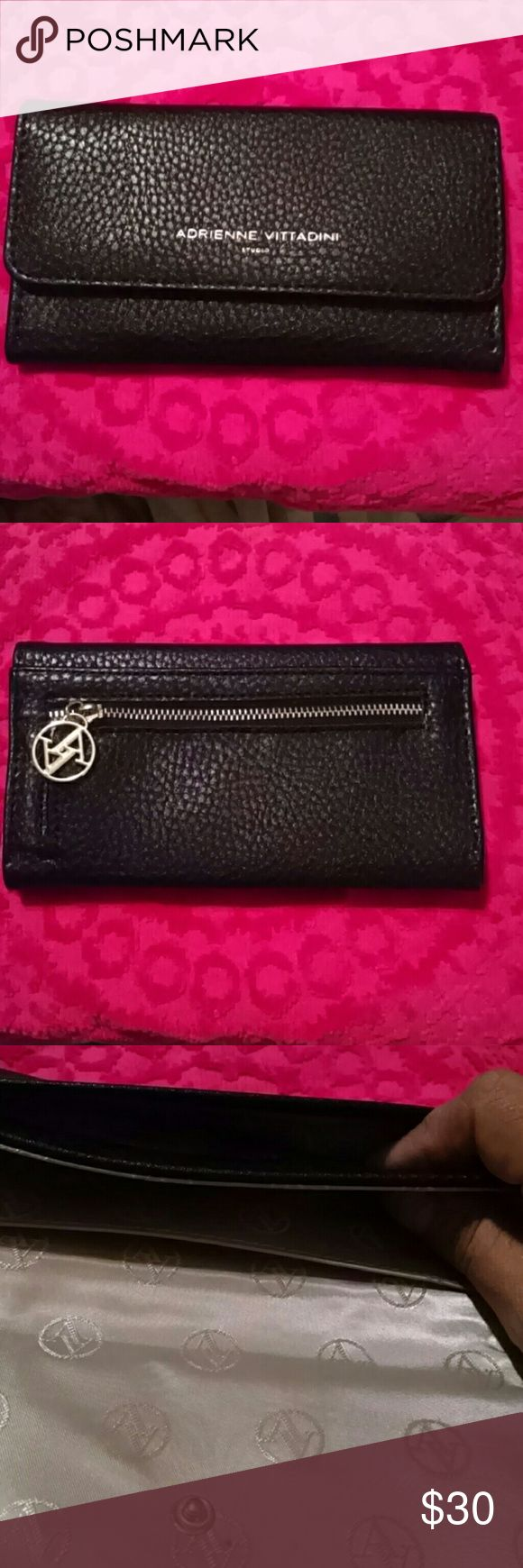 Adrienne Vittadini skinny wallet black Gently used once, just to skinney for my use. In good condition and also has a coin change zipper on the back side.  Great for on the go with little to carry.  Like for date, girls night out. Adrienne Vittadini Bags Wallets
