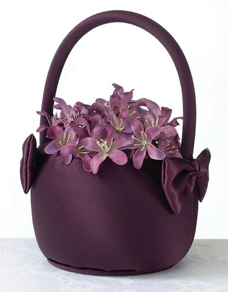 This 7 inch tall Purple Wedding Flower Girl Basket is covered in rich, purple-colored satin material.  The sides of the basket are accented by purple satin bows.