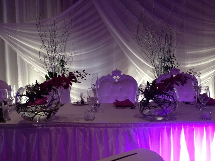 Branches of dendrobium orchids on the head table