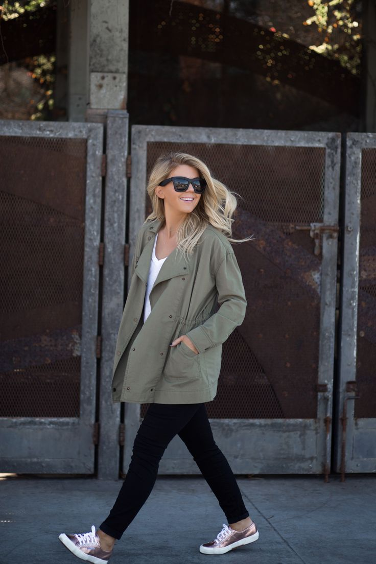Lisa Allen of LunchPails and Lipstick wearing a green army jacket from amuse society with rose gold sneakers and madewell maternity jeans