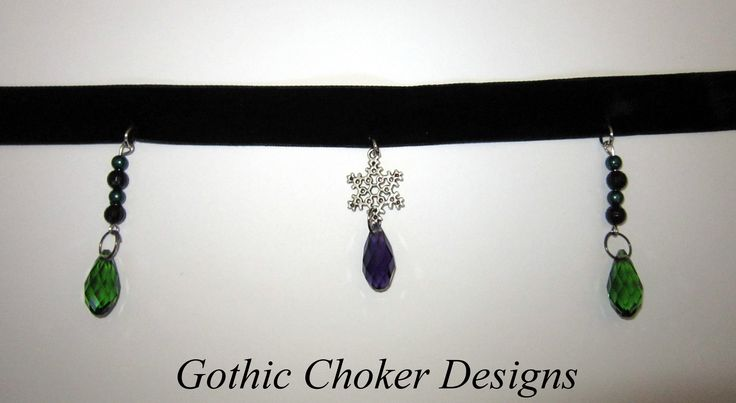 Black velvet choker with snowflake charm, purple and green glass crystals and green and black beads. R140 approx $14.  Purchase here: https://hellopretty.co.za/gothic-choker-designs/green-and-purple-christmas-choker