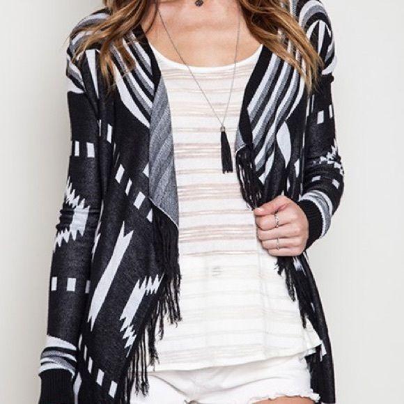 SALEBlack/white tribal print cardigan Black/white tribal print cardigan- 1 Lg left! Lg size 12-14 Trendy Tags Boutique Tops