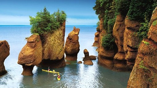 "Bay of Fundy, New Brunswick, Canada:  Here in the Bay of Fundy, the world's highest tides flow in and out twice a day covering a height of four stories. This makes for some pretty interesting walks, most notably on the ocean floor at low tide. Wonderland? A miracle of nature? Yep, there are a number of monikers that fit just fine at this stunning marine park. Need inspiration for another one? Just look up the massive local ""Right Whale."""