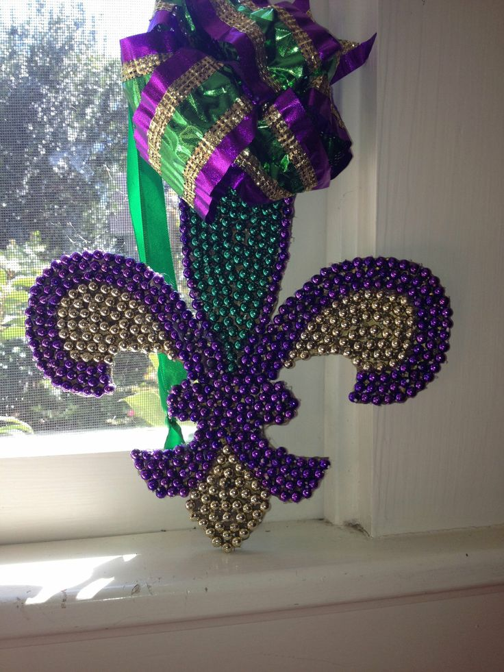 Mardi Gras Fleur De Lis made with Mardi Gras beads...repurposing at its finest!!