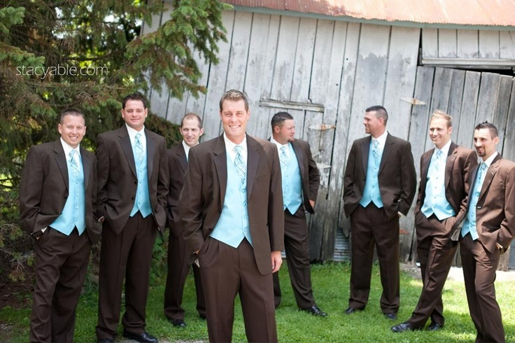 Turquoise and Brown Tuxedos- kind of like ours except our tuxes are tan not poop brown and a brighter blue for the vest and tie!