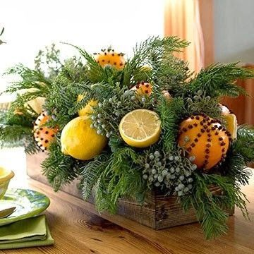 Citrus studded with cloves mixed in with evergreens.