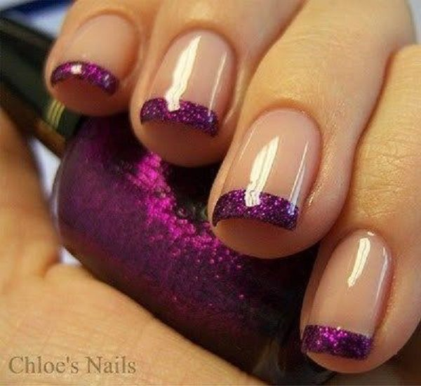 Simple yet pretty French tip Purple nail art design. The tips are coated in purple glitter making it more glamorous than usual with the combination of the nude matte background.