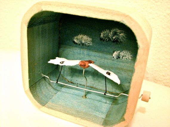 flying bird automaton in upcycled wood box by cartoonmonster