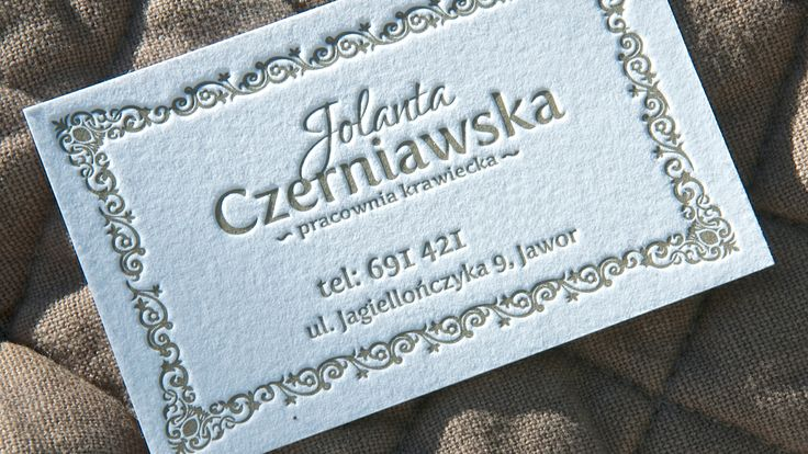 Tailor workshop card with an elegant frame. Dark gold ink pressed into thick cotton paper.