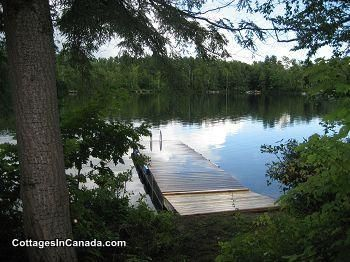Gatinau rental, sleeps 8, 4 bedrooms. Newly constructed cottage is situated in a peaceful setting on lake front property.  There is a  ...