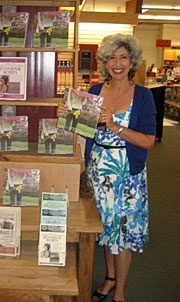 Showing off Growing More Beautiful at a bookstore event.
