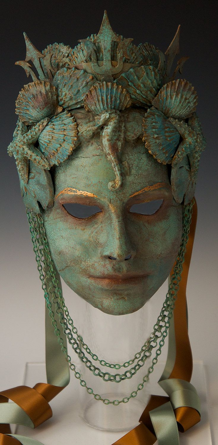 OUT-OF-STOCK/MADE-TO-ORDER: lead time is 5-8 weeks. Please convo me before purchasing.  This lovely mask could have just been brought up from the depths of the Mediterranean Sea, where shes been ruling the depths with Neptune (note his trident in her crown). The look is old bronze with a verdigris patina, but of course its light weight paper mache, another in a series of trompe loeil metallics Ive been doing.  The shells, seahorse, and sand dollars are all hand made out of the same paper...