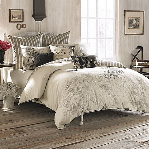 Romance and vintage flair are in perfect harmony with this beautiful bedding ensemble. The Anthology Amour Reversible Comforter Set features a beautiful all-over print on shades of antique gray and parchment.
