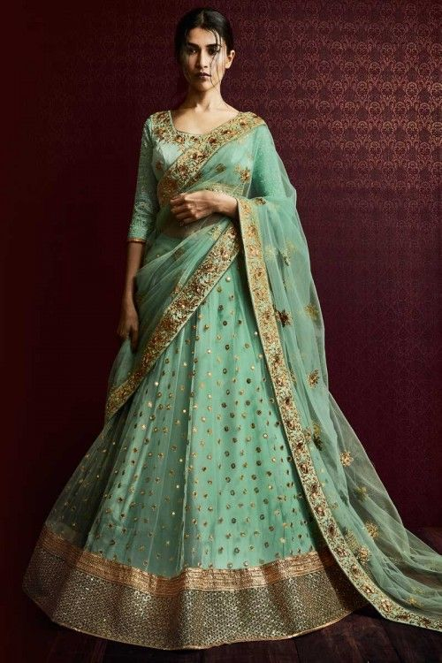 Pista Green Net Lehenga With Bhagalpuri Choli Pista Green net semi stitch lehenga with bhagalpuri choli. This lehenga choli is embellished with resham, sequins and embroidered .Product are available in 34,36,38,40 sizes. It is perfect for Wedding Wear.  http://www.andaazfashion.co.uk/womens/lehenga-choli