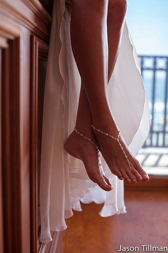 Bride's barefoot sandals shot. Beach wedding