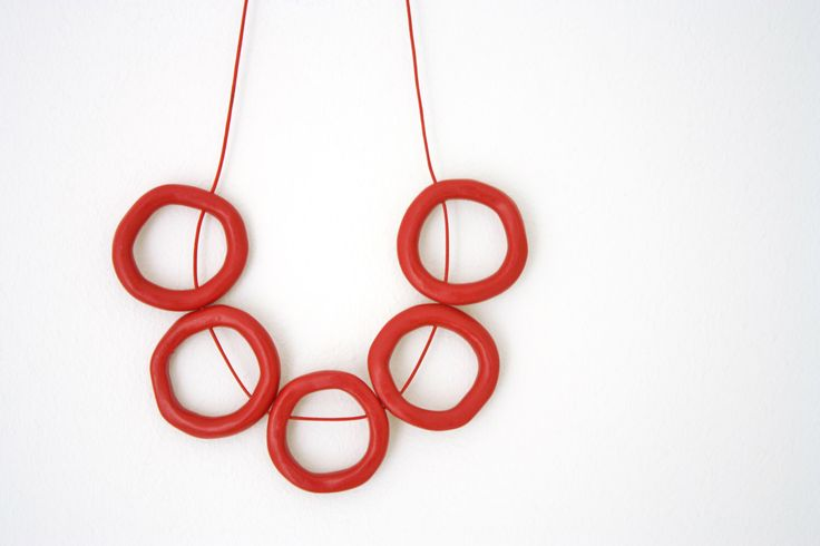 Minimal red polymer clay necklace, abstract, circles leather cord jewelry by debroervandevogel on Etsy https://www.etsy.com/listing/158392205/minimal-red-polymer-clay-necklace