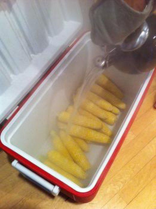 """Cooking Corn in a COOLER - Are you Serious... You BET!! Cooler Corn is a fun and easy way to cook corn on the cob for a large crowd. It's so easy that you will ask yourself """"Why didn't I think of that?!"""""""