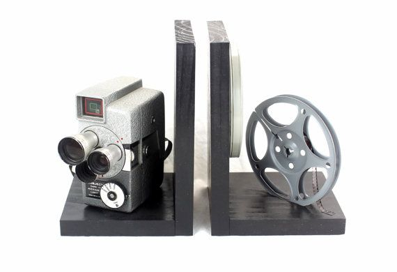 Original Wollensak Model 73 8mm Camera, 8mm film and film reel – modified into a pair of bookends. Unique cameras with some signs of years of service. This is an original vintage movie camera and not a replica. The bookends are also a great gift and add a little vintage flair to any room. These are nice gifts for the movie fan or the vintage lover. They are also perfect to display your DVD collection and decorate your home theater or any room with a little vintage movie décor. Each Bookend…