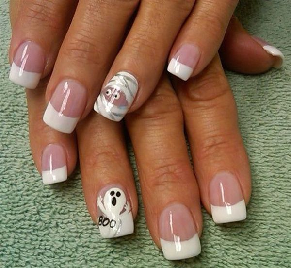 Mummy and ghost inspired Halloween nail art design. A simple white French tip has never looked any better than with mummies and ghost out and about for spookiness.