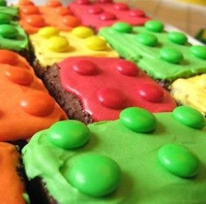 Fast, Easy LEGO Cake Bites - 247 Moms - easy bake brownies cut into rectangles, ice with bright icing top with MMs in matching colours! Yummo