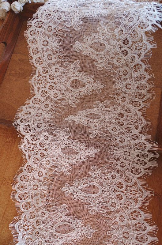 * Goegeous ivory alencon lace fabric SIZE: Fixed width is 8.6 inches . the piece can be cut into two strips of individual lace trimming for bridal veil, bridal dress, wedding table runners FOR ORDER OVER 3 YARDS, IT WILL BE IN TWO PIECES. THE FABRIC IS 3 YARDS PER PIECE   * Symmetrical embroidery floral pattern, with lovely flowers in the middle, scalloped border . you can also cut and use separately .  * Perfect for wedding dresss accessories, bridal lace shrug, wedding table runner…