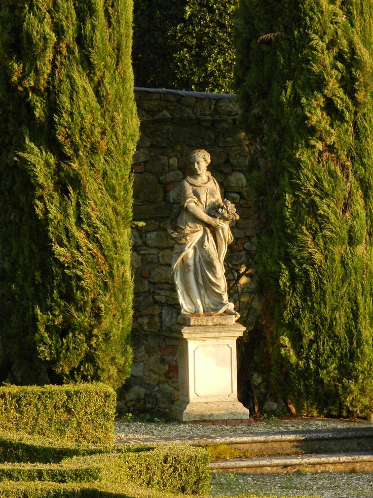 Stone Statue Basking In The Setting Sun Between Typical