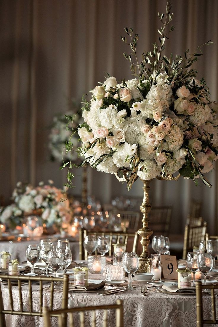 Wedding Reception Inspiration | Romantic Floral Centerpieces | Raised Centerpieces | Gold Chairs | Lace Tablecloths | Gold Candlebra with White Florals