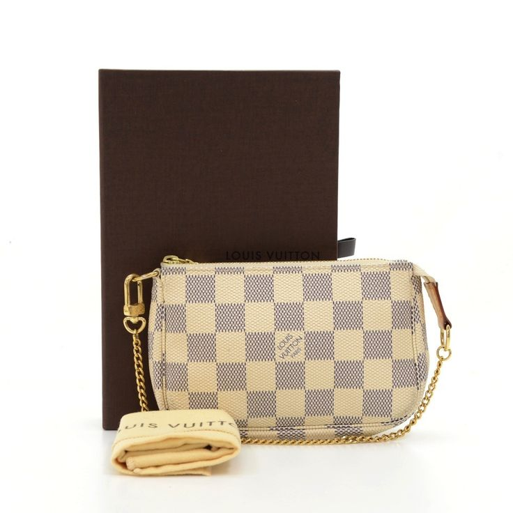 Authentic Louis Vuitton mini pochette accessories in azur canvas. Perfect for a night out and parties. It can be either hand-held or linked to the D-ring found in many Louis Vuitton. #LouisVuitton @fmasarovic