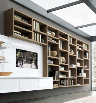 """A real innovation refreshes the concept of bookcases. The panels of which it consists, with less weight, allow the bookcase to be hanging giving a very new sense of """"visible lightness"""".…"""