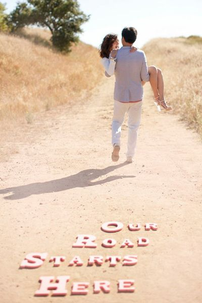 Use craft letters or a sign to add an extra dimension to your engagement photos. The photos serve a multitude of purpose: You can display them at your bridal shower, turn them into a guest book, or use them for your save-the-date.