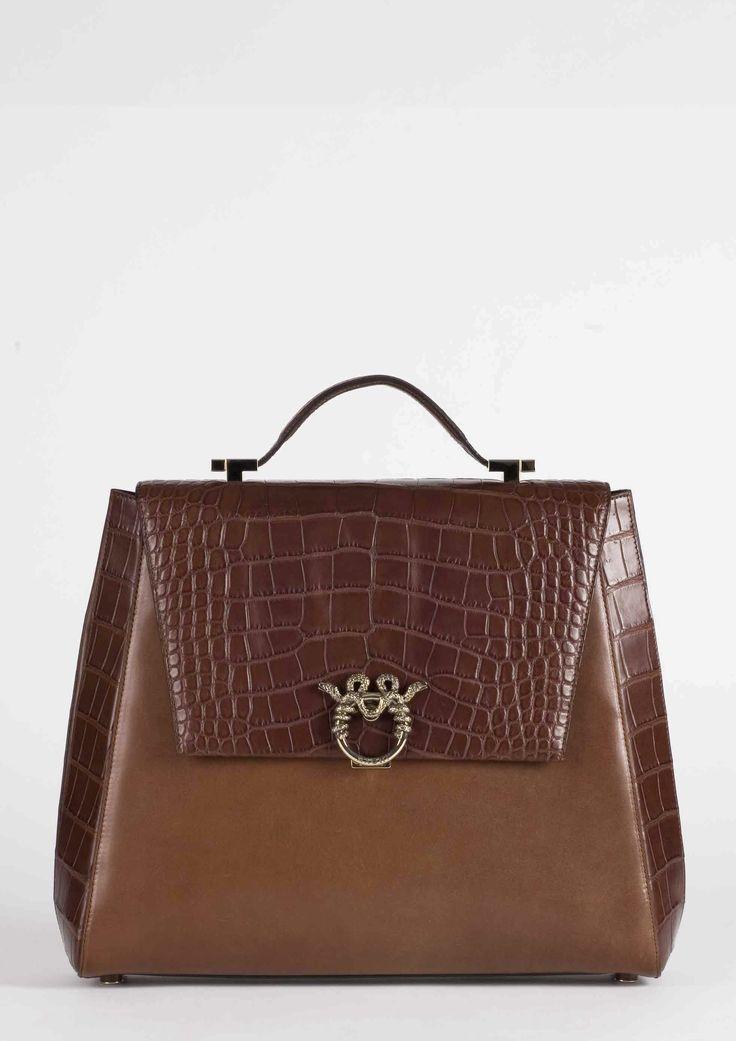 "MAGRÌ ""WORLD TRAVELER"" shown in Crocodile and Saddle Waxed Cowhide  #magri_handbags #magri #craftedinflorence #italianstyle #TimelessElegance #Sophisticated #MadeInItaly #italianCraftmanship #ItalianGlamour #luxuryHandbags #Handbags #powerbags #magribag @magriofficial #gentlemanclub #etabetapr #magripress www.magri.com"