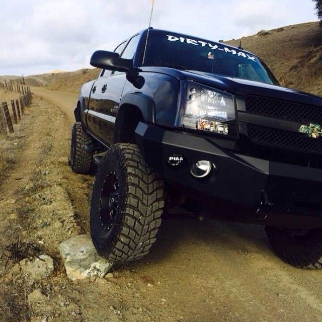 Black Chevy Duramax Lifted, off roader, dirt road, fence, rocks, cloudy sky, tipping, exploring, transportation, photograph, photo