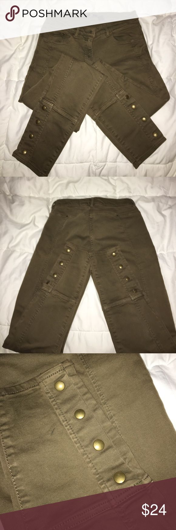 Olive skinny jeans with button detail Up for grabs is this super fabulous pair of boots olive skinny jeans.  Sleek, slimming fit with stretch and bottom details at the ankle.  Compliments galore with these jeans! H&M Pants Skinny
