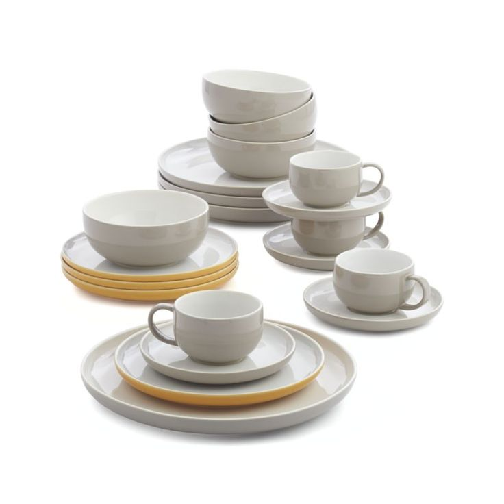 Clean, cool remix of mid-century modern, re-imagined for the contemporary table in a three-tone color palette of bone white, mist grey and sunglow orange.  Iconic shapes counterpoint with the curvy asymmetry of retro-inspired serving pieces.  A bright and creative contrast with more traditional dinnerware. StonewareDishwasher-, microwave- and oven-safe to 200 degreesMade in Portugal.