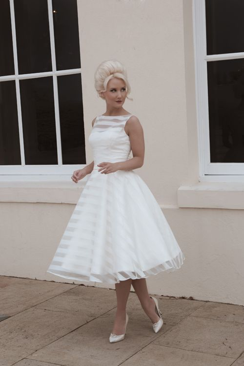Holly - Tea length full circle skirt of satin and organza striped sleeveless wedding dress. Stunning in its simplicity yet modern and cute. A gorgeous tea length satin gown with full circle skirt overlaid in an ivory striped organza.