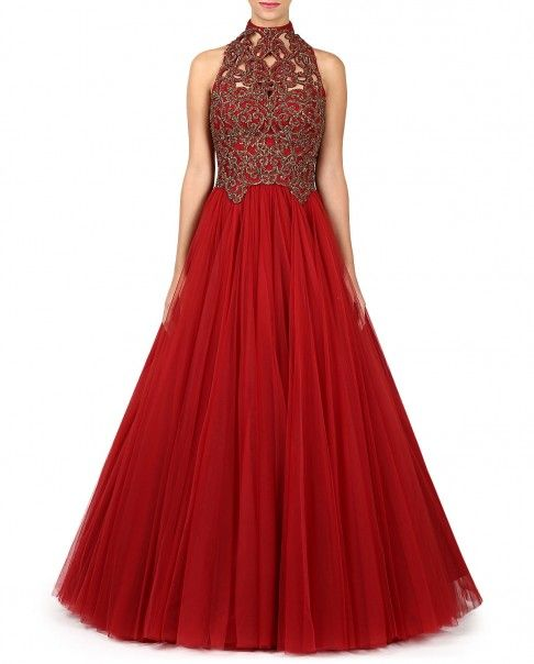 Red sleeveless gown styled with high neckline. Embellished bodice with cutwork styling. Zip closure at the back. Wash care: Dry clean only