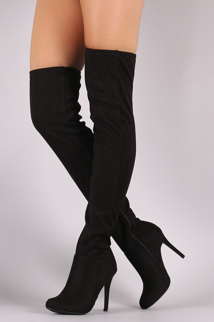These fitted boots feature a slightly stretched vegan suede upper, round toe silhouette, and wrapped stiletto heel. Finished with a cushioned insole and partial side zip closure. Material: Vegan Suede