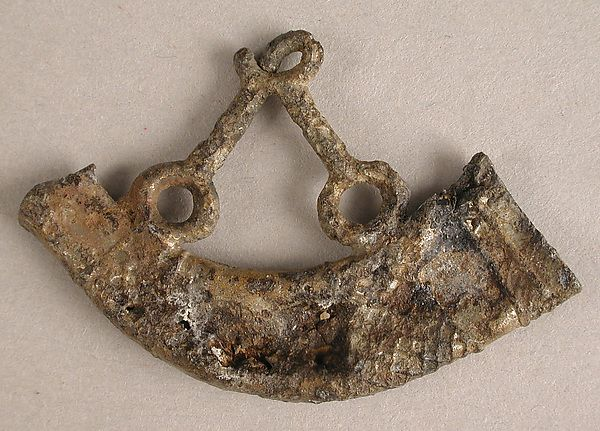 Badge with Hunting Horn Date: 15th century Culture: British Medium: Tin/lead alloy Dimensions: Overall: 1 1/8 x 1 11/16 x 1/8 in. (2.8 x 4.3 x 0.3 cm)