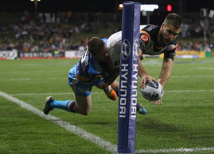Beau Ryan of the Tigers dives over to score a try during the round 25 NRL match between the Wests Tigers and the Gold Coast Titans at Campbelltown Sports Stadium on August 29, 2011 in Sydney, Australia. #NRL #Sports #Rugby