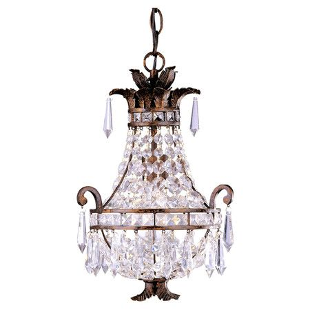Add a touch of glamour to your foyer or dining room with this elegant mini chandelier, featuring crystal accents and a tortoise shell finish.  ...:
