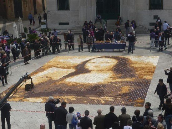 Mosaic artist Laura Hadland made a giant Mona Lisa Mosaic out of bread in Matera, Italy (also known as the city of bread). The mosaic, which was 29 feet wide and 35 feet long, took 10,080 pieces of bread and 3 hours to create. Three types of breads were used: plain, toasted and bread with dark and milk chocolate poured on top of it. so that's y theres the super dark setting on the toaster