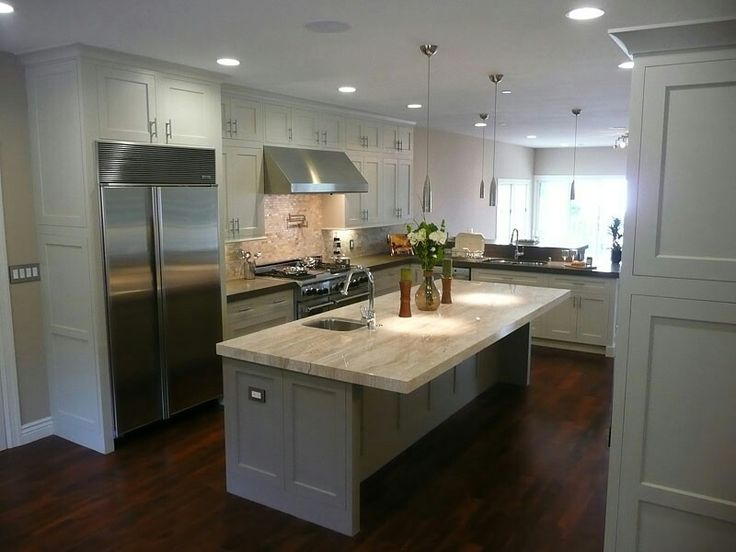 Dark wood floors grey island white cabinets light counters for Grey floor black cabinets