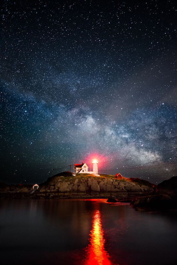 The . Milkyway rises .over the Nubble .  Lighthouse in Cape Needick Marine,*-*.